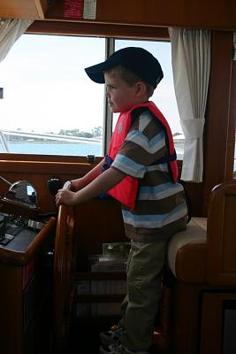 Click image for larger version  Name:ryan at the helm.jpg Views:81 Size:64.2 KB ID:1030
