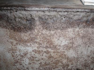 Holes after sand blasting.jpg