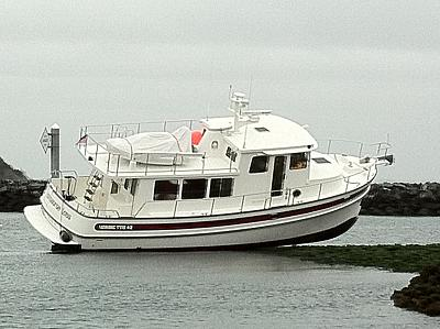 Click image for larger version  Name:tug on the rocks 2.jpg Views:197 Size:131.0 KB ID:75948