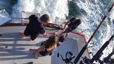 kids tossing bait.jpg