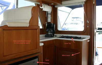 Click image for larger version  Name:helm seat & galley.jpg Views:140 Size:115.7 KB ID:9165