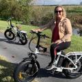 Wife and I on electric bikes with gator in the background